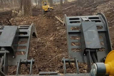 dozer cleaning by railroad grade