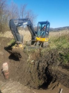 Escavator digging pond